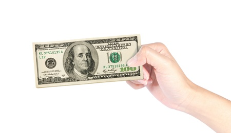 100 dollar bills in hand, isolated on white background photo