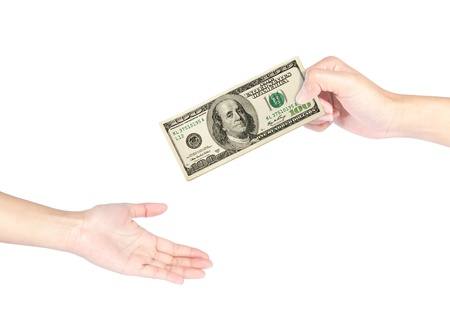 Hand handing over 100 dollar bills to another hand isolated on white background