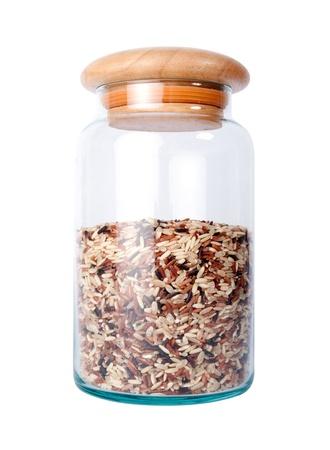 Riz brun dans une bouteille en verre isolé sur blanc Banque d'images - 18962756