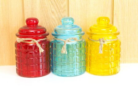 Blue , red , Yellow glass jar, front view