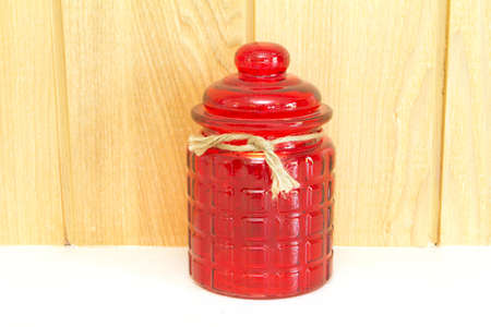 Red glass jar, front view
