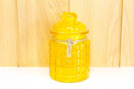 Yellow glass jar, front view Stock Photo