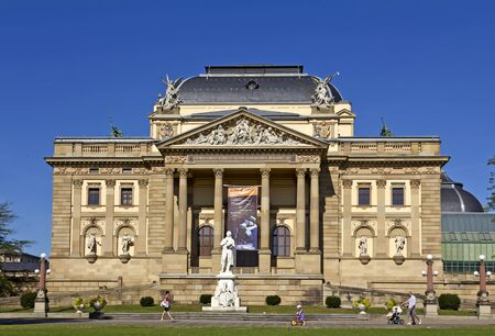 Wiesbaden (Hesse, Germany), October 1, 2011: Friedrich von Schiller Memorial (Sculptor: Joseph Uphues, 1850-1911) in front of the Hessian State Theater in Wiesbaden, Hesse, Germany.