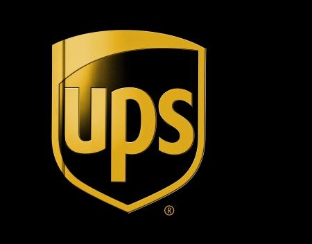 UPS の茶色のトラックの裏面の表示します。UPS はその茶色のトラックとしてまた知られているパッケージ車で知られています。 報道画像