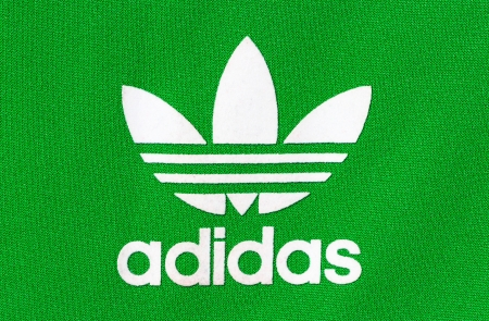 Adidas: German multinational corporation producing sportswear located in Herzogenaurach, Germany Editorial