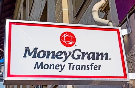 street name sign: Marburg, Germany - April 12, 2013: Branch of the global money transfer company Moneygram Inc. headquartered in Dallas, Texas, USA. Main products: global money transfer, bill payment services, money orders, and check outsource services.