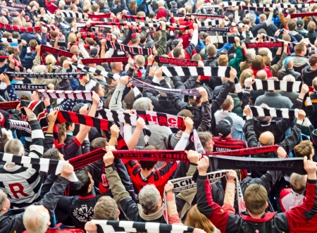scarves: Frankfurt, Germany, May 4, 2013: Eintracht Frankfurt Football Club supporters before the match against Duesseldorf team.