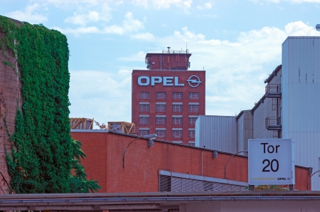 multinational: Ruesselsheim, Hesse, Germany - July 27, 2013: Tower and plant of the headquarter of German automobile company Adam Opel AG