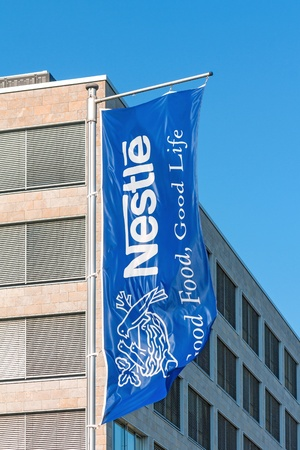 multinational: Frankfurt, Germany - July 7, 2013  Blue company flag of Swiss multinational food and beverage company Nestle S A