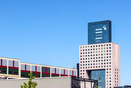 Frankfurt, Germany - July 21, 2013: Messe Torhaus laso called Gateway to Frankfurt shaped like a guiiotine, serves as admin office building to Frankfurt Trade Fair (Messe Frankfurt)