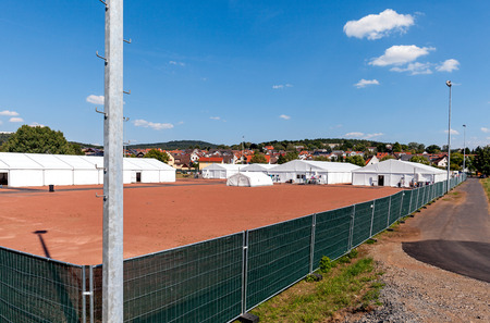 refugees: Marburg, Germany - August 1, 2015: Camp for refugees and migrants at the football ground at the district of Marburg Cappel Editorial