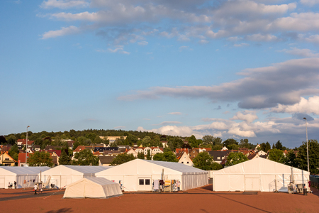 influx: Marburg, Germany - July 29, 2015: Reception Camp for refugees and migrants at the football ground in Marburg.