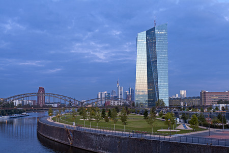 ecb: Frankfurt am Main, Germany - September 9, 2015: New Head Office of the European Central Bank ECB in front of skyline of Frankfurt Editorial