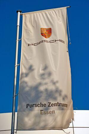 famous industries: Essen, Germany - November 1, 2015: Flag of a car dealer of German automobile manufacturer Porsche AG owned by Volkswagen AG in Essen, Germany.