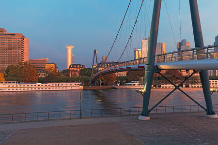 sachsenhausen: Frankfurt am Main, Germany - October 24, 2015: bridge over Main River leading Holbein to the Financial District Editorial