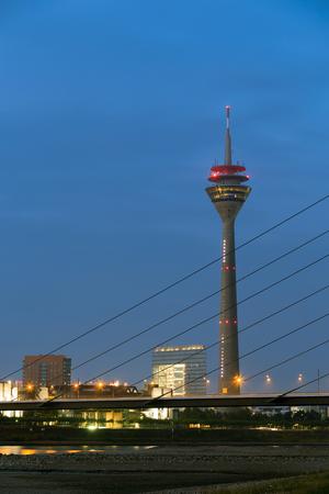 rhine westphalia: Duesseldorf, Germany - October 4 2015: City Gate City Gate and Rhine Tower Rheintturm - telecommunicatiosn tower of Dsseldorf, capital of the federal state of North-Rhine Westphalia, Germany