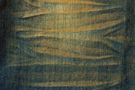 Texture of used jeans cloth photo