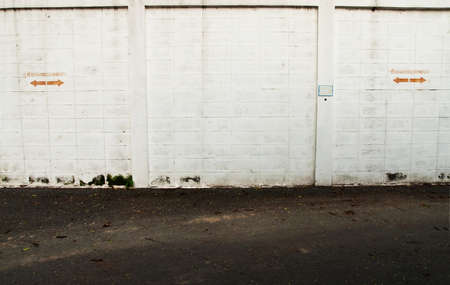 Grunge white wall in car park photo