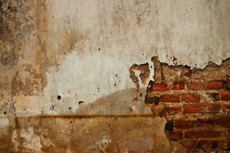 Crack grunge concrete wall may be used for background Stock Photo