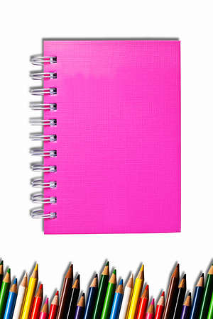 Pink notebook and color pencils photo