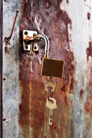 Grund key and lock on zinc metal plate photo