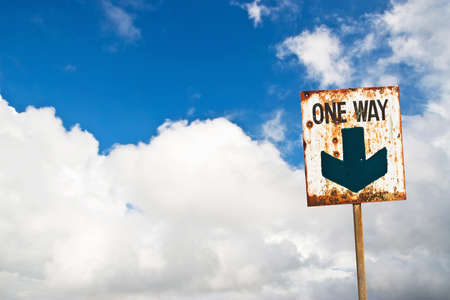One way sign on cloud blue sky photo