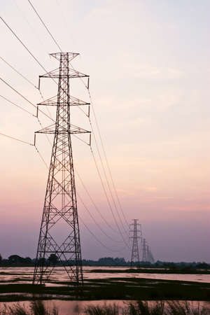 high tension: High voltage pole in sunset Stock Photo