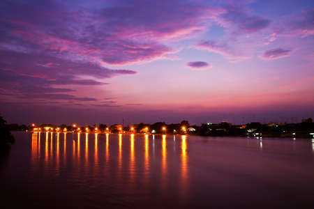 Colorful of light beside the river in twilight photo