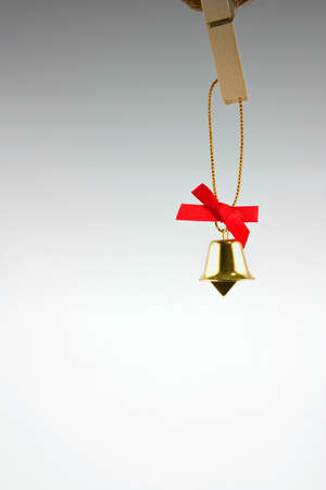 Golden bell and red ribbon Stock Photo - 9196061