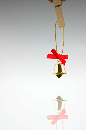 Golden bell and red ribbon reflex Stock Photo - 9196063