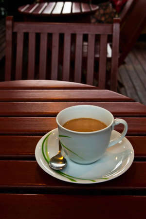 A cup of coffee on wood table Stock Photo - 9242485