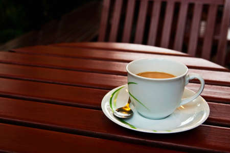 A cup of coffee on wood table Stock Photo - 9242506