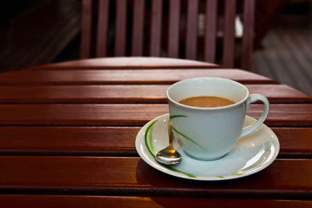A cup of coffee on wood table Stock Photo - 9242507