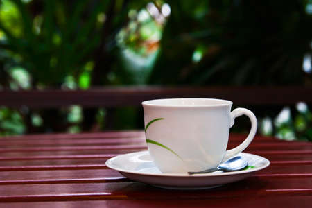 A cup of coffee on wood table Stock Photo - 9242481