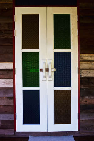 White wooden door and color glasses Stock Photo