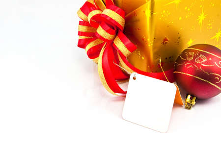 White tag and x mas ball beside gif box on white Stock Photo - 9380731