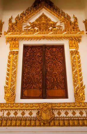 Thai design sculpture on churchs window photo