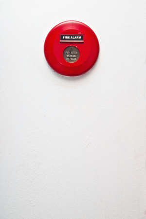 Fire alarm on white concrete wall photo