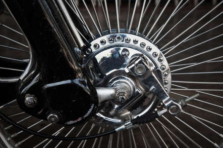Vintage wheel of motorcycle photo