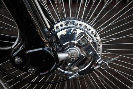 Vintage wheel of motorcycle photo