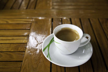 A cup of coffee on wooden table Stock Photo - 9514971