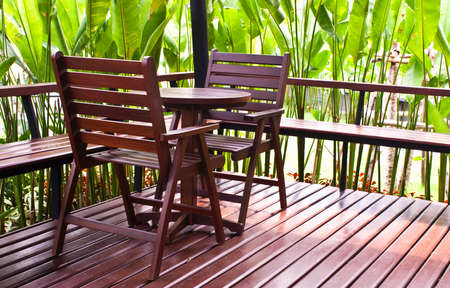 the place is outdoor: Wooden chairs and table in coffee shop