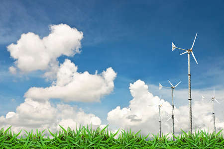 Turbine wind mill on green grass against cloud blue sky photo