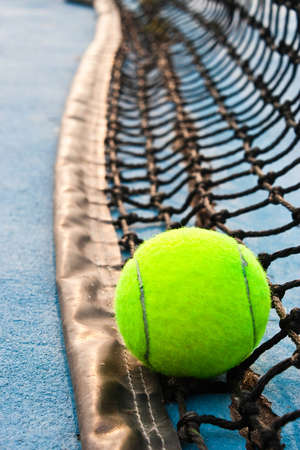 Tennis ball and net on the court photo
