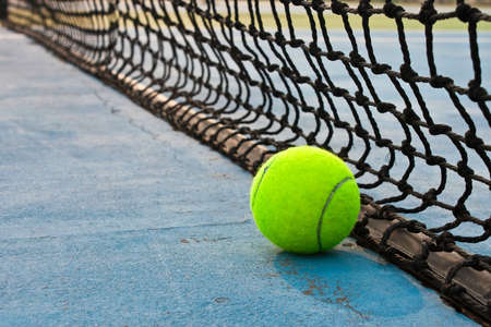 lawn tennis: Ball and net on tennis court Stock Photo