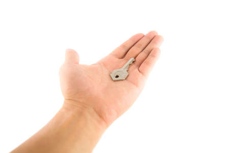 A key on left hand, isolate on white background photo