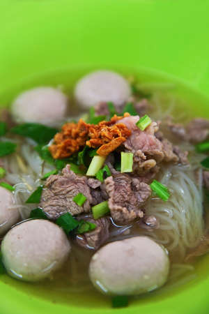 Beef noodle soup in green bowl