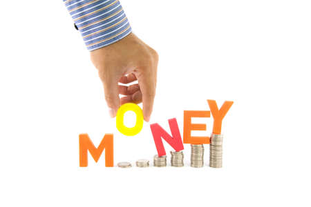 Hand pick up money wording from coins stack Stock Photo - 9859149