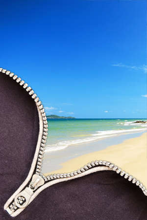 Blue sea and beach by opening a zipper Stock Photo - 9990534