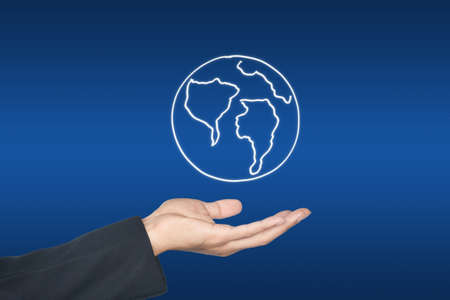 Hand and world map icon, on blue background Stock Photo - 10078498